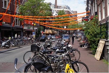 One of many scenes of orange flags & bicycles all over the city before the big game!
